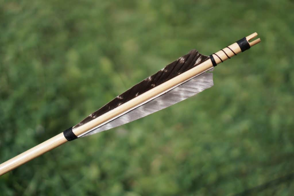 A picture of a broken arrow. There are several ways to fix such an arrow. We will cover this in the article. The article is a full going on how to change the nock, the arrow and fletching. You will learn everything on how to fix a an arrow and what glue to use for your arrows as well.