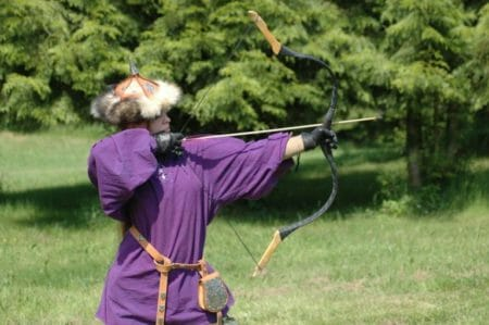 a man shooting with a yumi bow