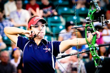 a picture of a women with bad eyesight in the olympics. Practise a lot of archery and you will get a better eyesight