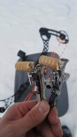 Picture of two hand held bow releases