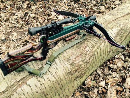 picture of crossbow and crossbow bolts in the woods