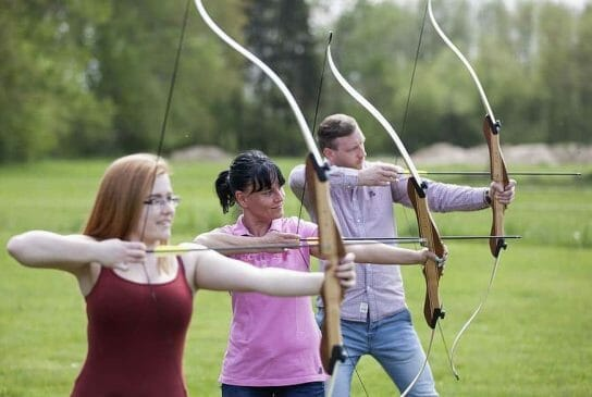 group aiming their bow