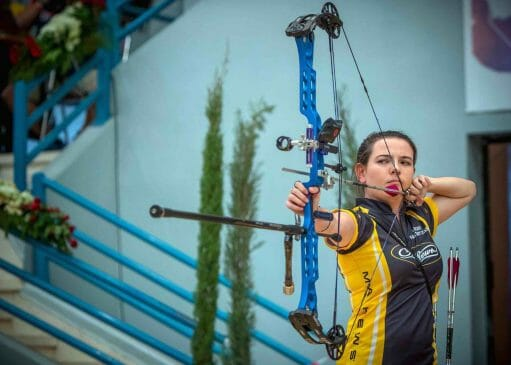 woman aiming her bow